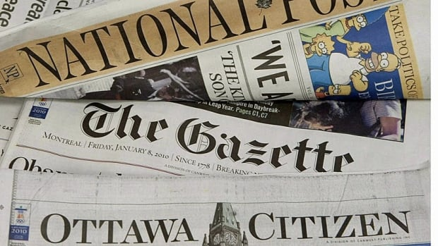 Some of Postmedia's newspapers are displayed. The company will soon stop producing Sunday newspapers in three of its largest publications.