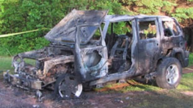 Police and firefighters found two bodies in the burned out vehicle.