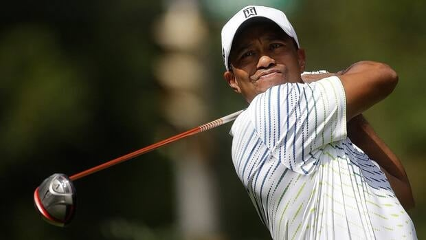 Tiger Woods watches his tee shot on the fourth hole during first round of play in the Tour Championship in Atlanta on Thursday. (AP Photo/John Bazemore)