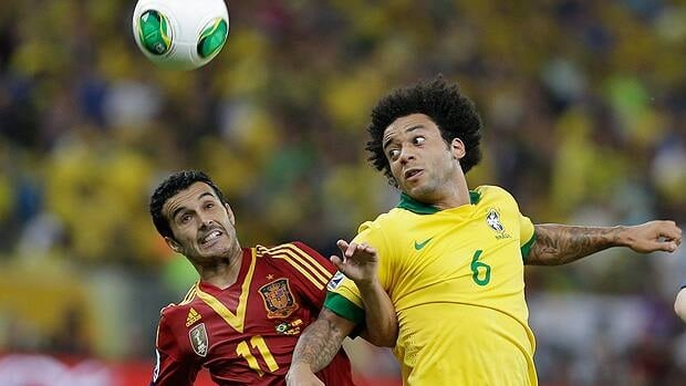 Spain's Pedro Rodriguez, left, and Brazil's Marcelo fight for the ball during the soccer Confederations Cup final match at the Maracana stadium in Rio de Janeiro last week.