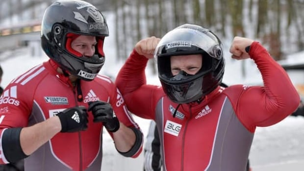 Lyndon Rush, right, and Jesse Lumsden of Canada celebrate during a World Cup race in Winterberg, Germany, Saturday, Dec. 8, 2012.