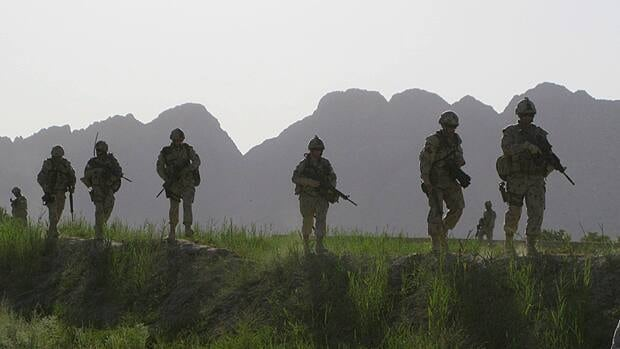Canadian soldiers patrol an area in the Dand district of southern Afghanistan in 2009. Soliders bear witness to stressful events, leaving mental scars that persist long after a combat mission ends.