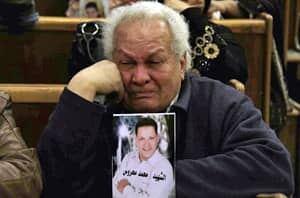 si-egypt-soccer-mourner-300-ap-03895878