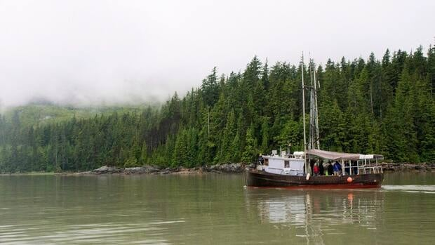 A boat passes the site of the proposed Enbridge Northern Gateway bitumen terminal on Douglas Channel, south of Kitimat, B.C. Northern Gateway has offered aboriginal groups along the route the opportunity to buy into a 10 per cent equity stake in the pipeline.