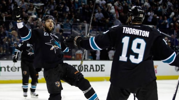 Sharks forward T.J. Galiardi, left, is congratulated by teammate Joe Thornton (19) after scoring in the second period against the L.A. Kings on Sunday night.