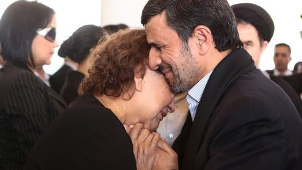 Iran's President Mahmoud Ahmadinejad, comforts Elena Frias next to the flag-draped coffin of her son, the late Venezuelan president Hugo Chavez, during the funeral ceremony on Friday.