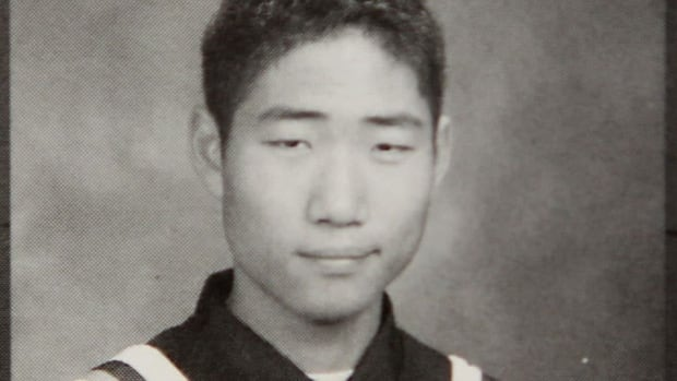 Aaron Yoon, who was identified in a CBC report as having travelled overseas with two high school friends and with being associated with the Algerian gas refinery attack, now faces a sentence in Mauritania five times as long as the original. He's shown in a 2006 yearbook photo from South Collegiate Institute in London, Ont.