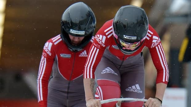 Kaillie Humphries, right, and Chelsea Valois during the World Cup race in Innsbruck, Austria, Friday, Jan. 18, 2013.