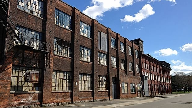 Developers need two good anchor tenants in order to move ahead with transforming the old Cannon Knitting Mills into The Mills Innovation Exchange.