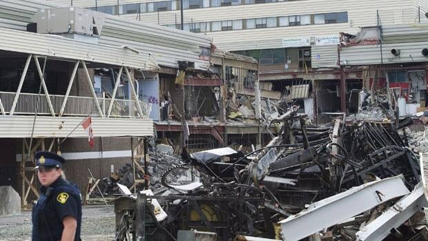 The owner of Alternative Funeral Service says more than 30 urns containing human ashes are trapped in the collapsed mall along with the records and phone numbers of the families.