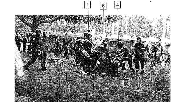 An image from a report prepared by the Office of the Independent Police Review Director shows the takedown of G20 protester Adam Nobody on the lawn of Queen's Park in Toronto on June 26, 2010.