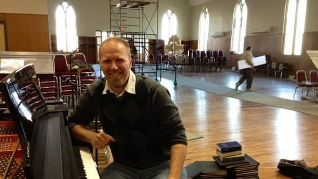 Chris Schoon says outreach has much to do with the future of his congregation's renovated church – and the shiny, new piano is part of that. He doesn't play himself, but has other talents.