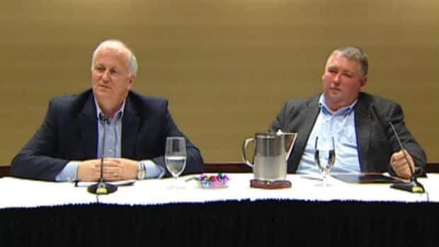 Martin and Blaine Sullivan of Ocean Choice International speak with reporters in St. John's on Jan. 9.