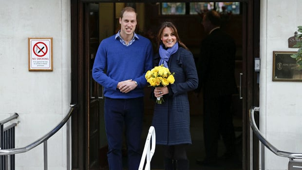 Britain's Prince William leaves the King Edward VII hospital with his wife, Kate, Duchess of Cambridge, in early December after she was hospitalized with acute morning sickness. Officials said Monday she is feeling better.