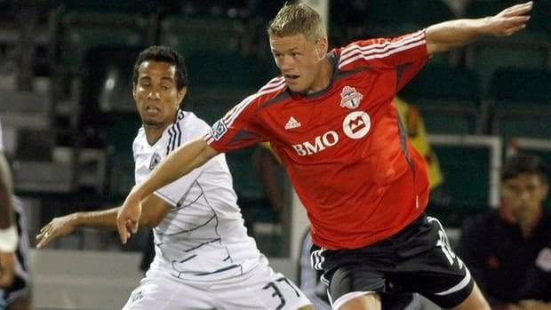 Toronto FC's Nick Soolsma, right, was one of the club's three players arrested for public intoxication.