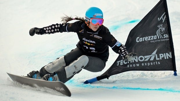 Caroline Calve clears a gate during the race in Carezza, Italy on December 21, 2012.