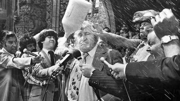 Former agriculture minister Eugene Whelan is hit on the head with a milk jug during a demonstration by dairy farmers in this 1976 photo. Whelan said in his autobiography that the federal government's refusal to bail out Quebec dairy farmers helped elect the Parti Québécois later that year.
