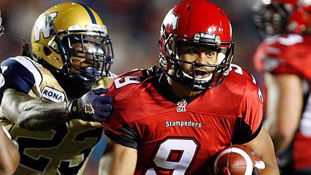 Jonathan Hefney, left, will now be a teammate of Calgary Stampeders running back Jon Cornish, right.