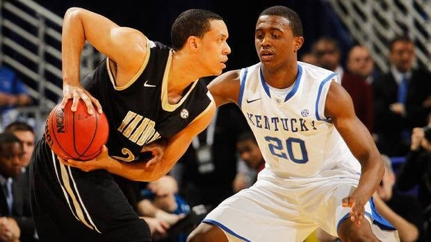 Doron Lamb of the Kentucky Wildcats, right, defends against Kedren Johnson of the Vanderbilt Commodores during the championship game of the 2012 SEC Men's Basketball Tournament.