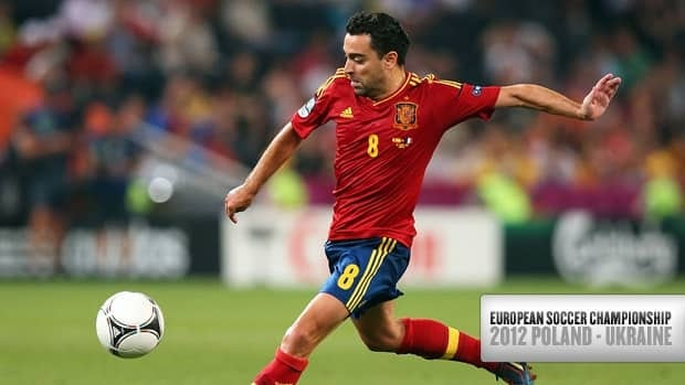 Xavi of Spain crosses the ball during the match against France at Donbass Arena on June 23 in Donetsk, Ukraine.