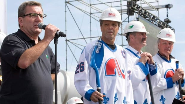 With former Nordiques Peter Stastny, Michel Goulet and Marc Tardif looking on, Quebec City mayor Regis Labeaume, left, speaks to fans at the ground breaking ceremony for the new NHL arena in Quebec City last year. Despite the ruling in Phoenix, Labeaume is still hopeful the NHL has plans for expansion in Quebec.