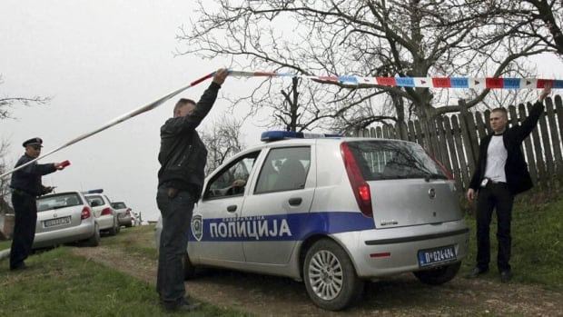 Police blocked off the area while forensic teams and investigators in white protective robes took evidence from homes in the village of Velika Ivanca, 50 kilometres southeast of Belgrade.