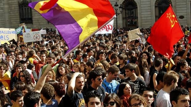 Students holding Republican and Communist flags protest against education cuts on Wednesday in Barcelona.