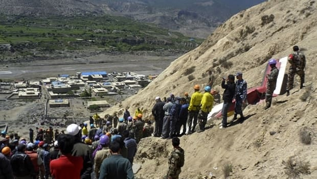 Nepalese rescue workers and officials inspect the site of a plane crash near Jomson, 200 kilometres northwest of the capital, Kathmandu, on Monday.