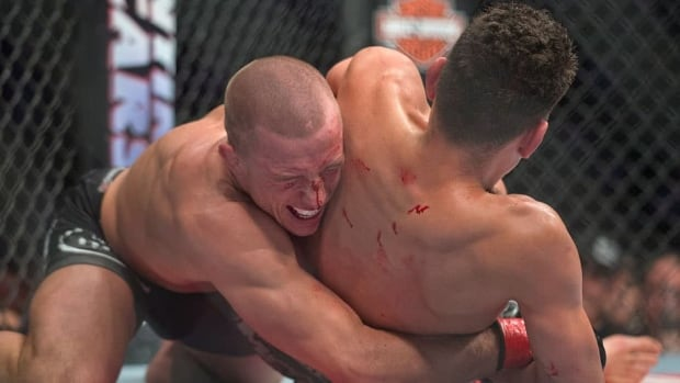 Canadian Georges St-Pierre, left, dominates Nick Diaz in all five rounds at UFC 158 on Saturday night in Montreal.