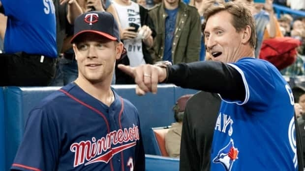Wayne Gretzky, right, chats with Justin Morneau of the Minnesota Twins before a game between the Twins and Toronto Blue Jays in Toronto last October.