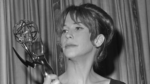 A 1962 file photo shows Julie Harris posing with her Emmy statuette she received at the Emmy Awards in New York City. Harris, who won an unprecedented five Tony Awards for best actress, has died. She was 87.