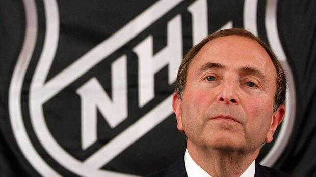 NHL commissioner Gary Bettman listens as he meets with reporters after a meeting with team owners on Thursday.