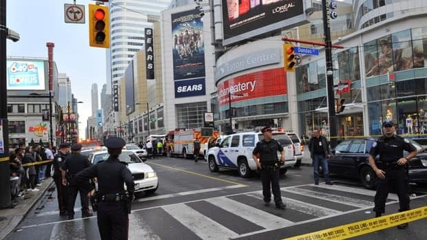 Toronto police are seen setting up a perimeter outside the Eaton Centre shopping mall in Toronto, following a shooting on June 2.