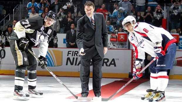 Evgeni Malkin, left, of the Pittsburgh Penguins and Alex Ovechkin of the Washington Capitals are seen here taking a ceremonial faceoff last season. The Russian superstars will be heading into the 2013 season as two of the hottest players that played overseas during the lockout.