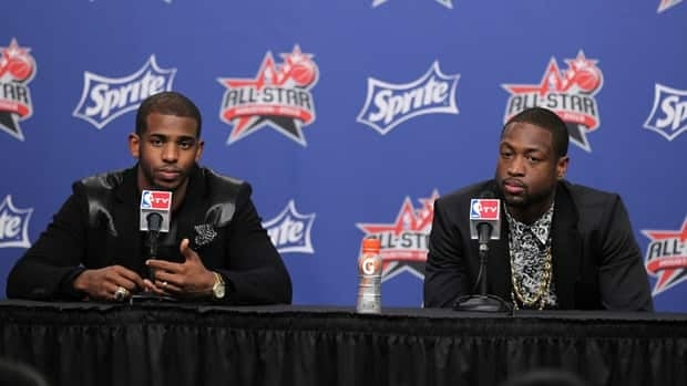 Dwyane Wade of the Miami Heat, right, and Chris Paul of the Los Angeles Clippers during a press conference on February 16, 2013 at the Toyota Center in Houston, Texas.