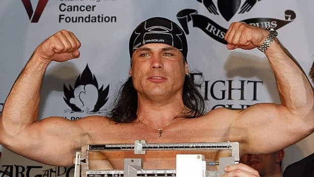 Conservative Senator Patrick Brazeau, seen taking part in a weigh-in for his March boxing match against Liberal MP Justin Trudeau, cited personal reasons for missing more sitting days that any other senator.
