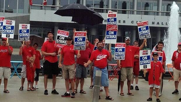 Picketing Coca-Cola workers in front of Kitchener city hall on July 9. Coca-Cola says it has reached a tentative agreement with its CAW represented workforce.