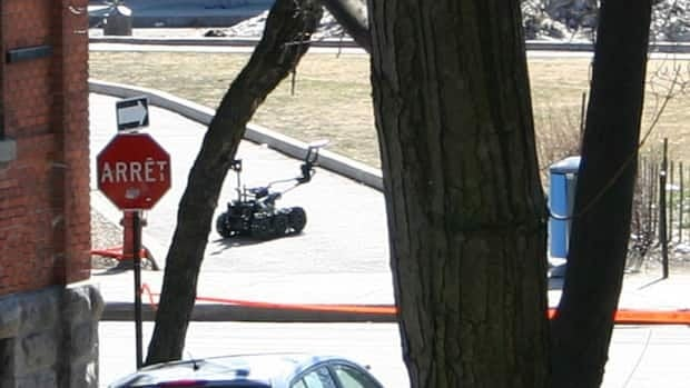 A special tactical team used a bomb-disabling robot to inspect and neutralize a suspicious package in Montreal on Wednesday.