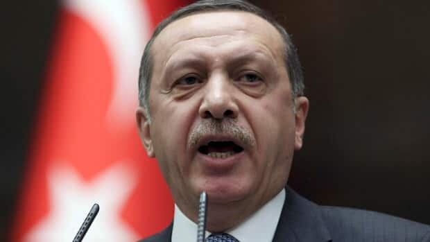 Turkish Prime Minister Recep Tayyip Erdogan said France's legislation was introduced because of a racist and discriminatory attitude toward his country.