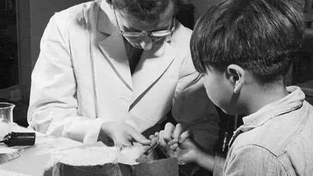 A nurse takes a blood sample from a boy at the Indian School, Port Alberni, B.C., in 1948.