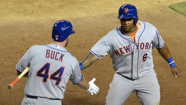 Marlon Byrd, right, and teammate John Buck will join the Pittsburgh Pirates from the New York Mets.