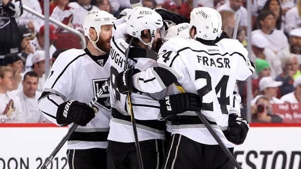 Drew Doughty (8) of the Los Angeles Kings celebrates his second period goal with teammates against the Phoenix Coyotes in Game 5 on Tuesday.