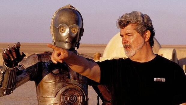 Star Wars creator George Lucas directs actor Anthony Daniels, who plays the robot C-3PO, on location in Tunisia. Lucasfilm is postponing the scheduled 3D releases of Star Wars: Episode II - Attack Of The Clones and Episode III - Revenge of the Sith to instead focus its efforts on Star Wars: Episode VII.
