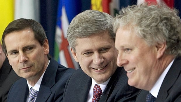 Ontario Premier Dalton McGuinty listens as Prime Minister Stephen Harper speaks with Quebec Premier Jean Charest, right, during a signing ceremony at a first ministers' meeting in Ottawa on Jan. 16, 2009. Harper has not had many meetings with provincial premiers and territorial leaders.