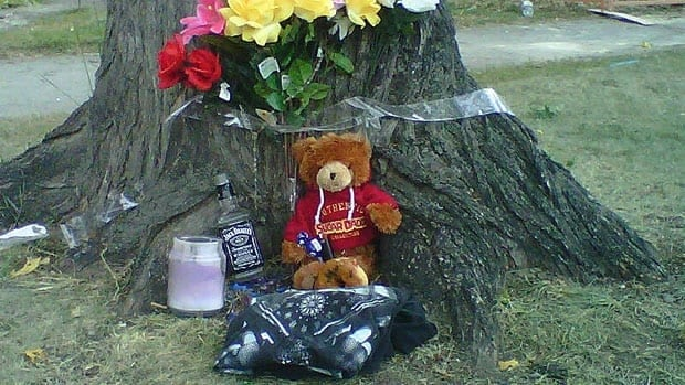 A makeshift memorial has been created near the scene of the fatal assault on Aberdeen Avenue.