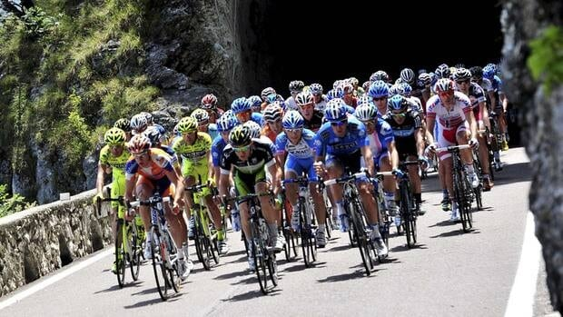 Cyclists pedal on the Dolomites Alps during the 16th stage of the Giro d'Italia on Tuesday, May 22, 2012.