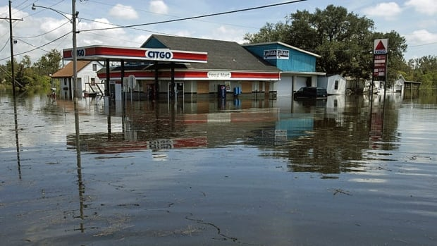 A gas station is partially submerged in floodwater in the aftermath of Hurricane Isaac in Louisiana on Sept. 1. At least five deaths in Louisiana and two in neighbouring Mississippi were blamed on Isaac and residents of the two states still suffered from power outages Saturday.