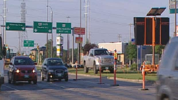 Construction for a separated bike lane on Pembina Highway in Winnipeg began Monday.