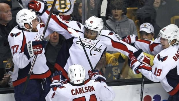 Joel Ward is congratulated by teammates after scoring a game 7 winning goal for the Washington Capitals in overtime.