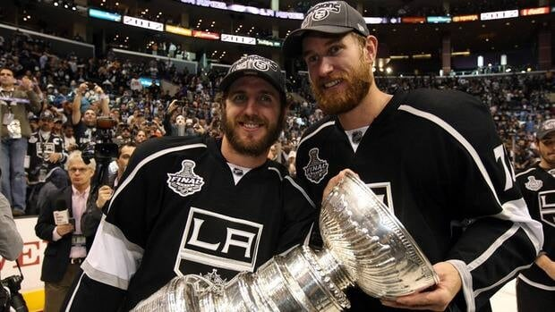Former Philadelphia Flyers Mike Richards, left, and Jeff Carter pose with the Stanley Cup after their Los Angeles Kings defeated the New Jersey Devils in the finals on Monday. Many NHL players took to Twitter to comment on the game, including a fellow former Flyers forward Joffrey Lupul.